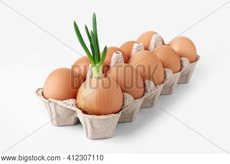 Chicken Eggs And Green Onions. Green Onions And Brown Raw Eggs In An Egg Box Isolated On White Backg