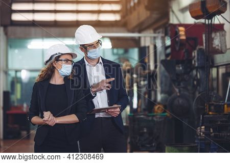 Engineer With Digital Tablet Supervising Autonomous Producton Process