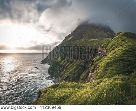 Faroe Islands With Stormy View Towards Mykines And Atlantic Ocean On The Island Of Vagar As Seen Fro