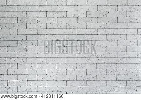 Loft Styled White Brick Wall. Surface White Wall Of Stone Wall Gray Tones For Use As Background. Bri