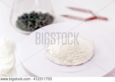 Aluminum Oxide In Petri Dish, On Digital Scale