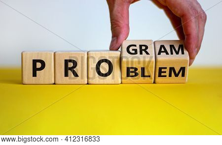 Solving A Problem And Making Program Symbol. Businessman Turns Wooden Cubes And Changes The Word 'pr