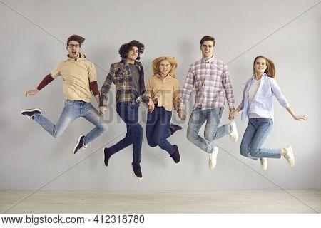 Full-length Portrait Of Enthusiastic Caucasian European Teenager Jumping High