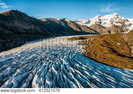 Aerial Of One Of Many Of The Receding Glaciers In Iceland. Shot From Close To The Glacier Highlighti