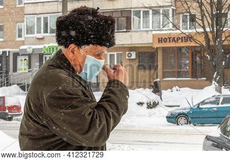 Lutsk, Ukraine - February 12,2020: Man Wearing Face Mask On Public Streets In Middle Of Coronavirus