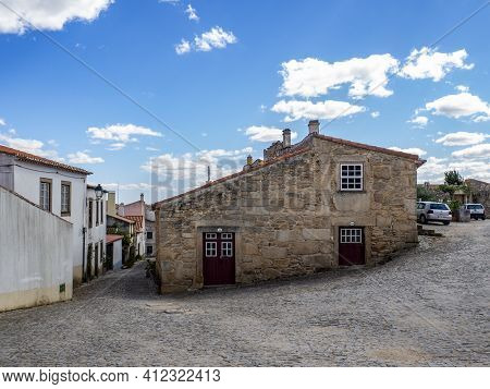 Almeida, Guarda, Portugal; August 2020: Entance And Fragment Of The Fortified Medieval Walls Of The
