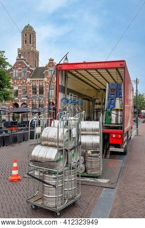 Zwolle, The Netherlands - July 31, 2012: Truck Unloading Metal Beer Tuns Downtown Dutch City Zwolle