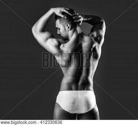 Man Or Muscular Guy With Sexy Muscle Torso, Naked Body, With Back Poses On Grey Background In Pantie