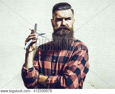 Young Hipster Hairdresser. Bearded Man In Barber Shop. Barber Scissors And Straight Razor, Barber Sh