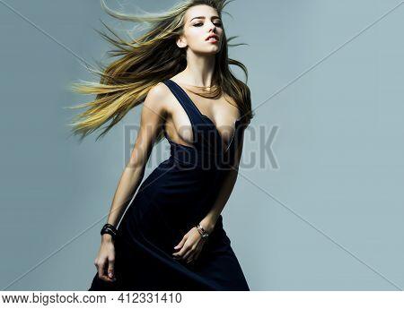 Fashion Woman Of Girl In Long Dress With Beautiful Healthy Hair. Beauty Fashion Model Girl. Fashion