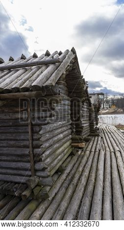 Araisi Lake Castle In Latvia. Historical Wooden Buildings On Small Lake Island In The Frozen Lake Ar