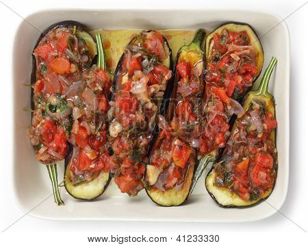 An oven bow packed with tomato, parsley and onion stuffed aubergines, just about ready for baking into a Greek imam baildi poster