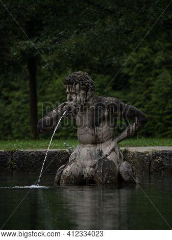 Closeup Portrait Of A Male Figure Statue Water Fountain In Schloss Hellbrunn Castle Gardens Near Sal