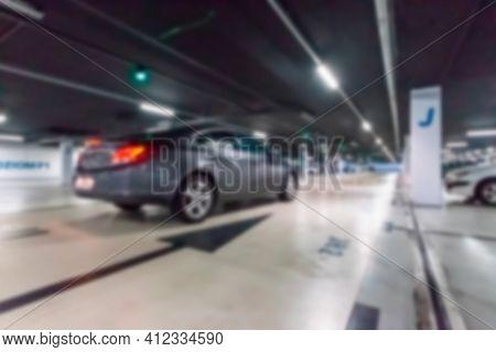 Garage Interior Blurred. Car Lot Parking Space In Underground City Garage. Empty Road Asphalt Backgr