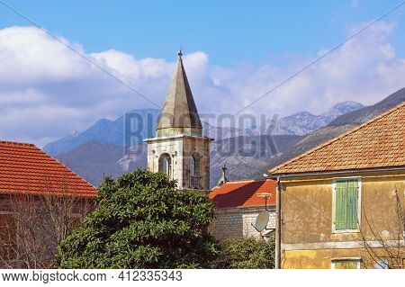 Mediterranean Village: Red Tiled Roofs  And Bell Tower Against Sky And Mountains. Montenegro, Tivat,