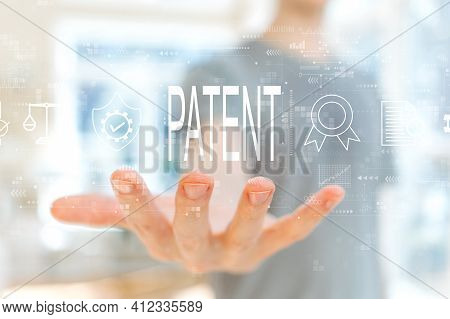 Patent Concept With Young Man Holding His Hand