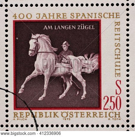 ZAGREB, CROATIA - SEPTEMBER 13, 2014: Stamp issued in the Austrian shows Equestrianism and horse riding, Spanish Horse Riding School in Vienna - At Long Rein, circa 1972.