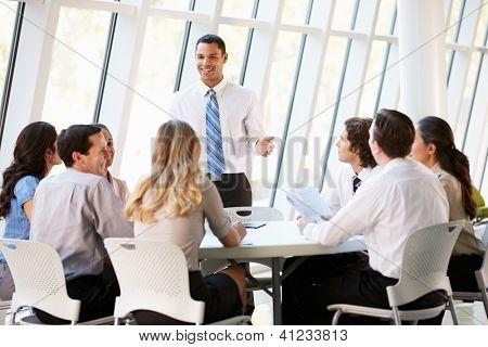 Business People Having Board Meeting In Modern Office