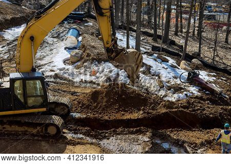 Excavator Is Digging A Huge Trench, Ditch For Drainage Canal Utility Pipe Pipeline Installation At C