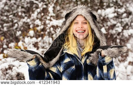 Fashion Girl In Wintertime. Beautiful Woman In Warm Clothing In Winter Park. Happy Female In Warm Co