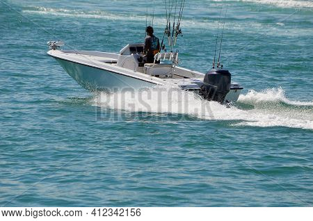 Open. Sport Fishing Boat Powered By A Single Outboard Engine.