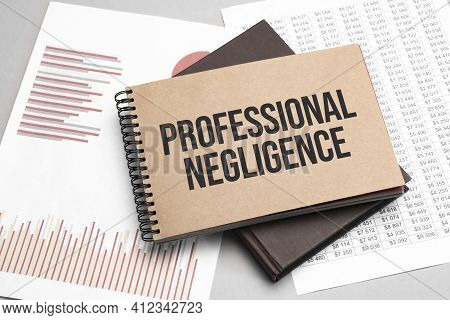 Notepad With Text Professional Negligence On A Charts And Numbers. Business Concept.