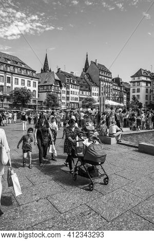 Strasbourg, France - July 29, 2017: Black And White Image Of Large Crowd Of People Pedestrians And L
