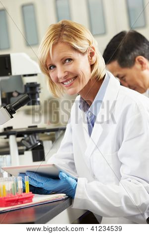 Female Scientist Using Tablet Computer In Laboratory