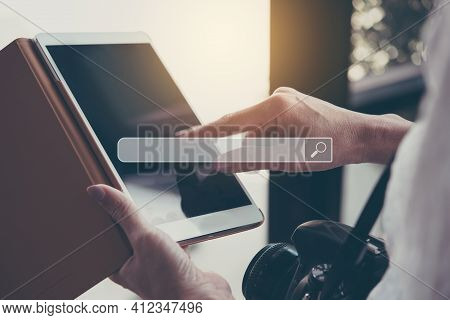 Closeup Of Female Hands Using Modern Digital Tablet For Searching Browsing Internet Data Information