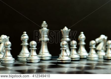 Silver Pawn Is On The First Move In Chess Game On Black Background (concept For Business Decision, S