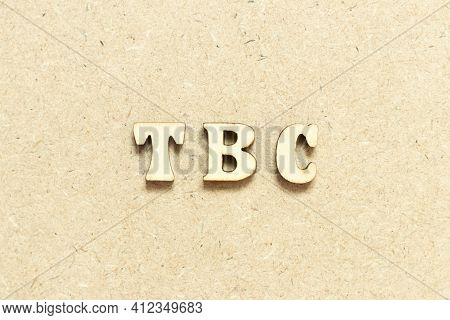 Alphabet Letter In Word Tbc (abbreviation Of To Be Confirmed Or Continued) On Wood Background