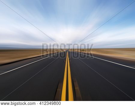 View of Pearblossom Highway with motion blur near Victorville in the Mojave Desert area of San Bernardino County California.