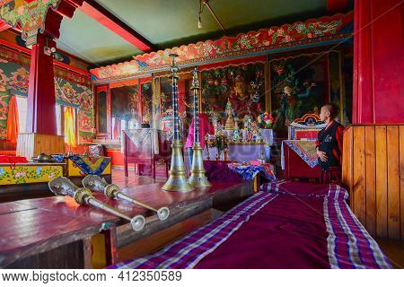 Rinchenpong, Sikkim, India - 17th October 2016 : One Young Boy Lama Standing Inside Prayer Room At R