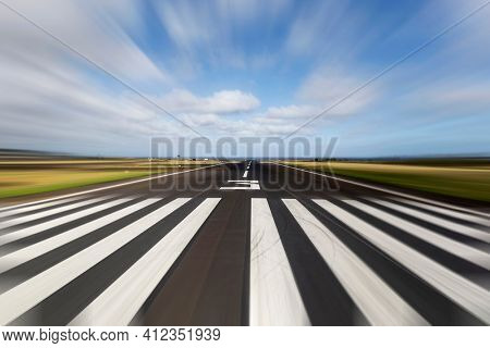 View of Hawaiian island tropical airport runway with motion blur.