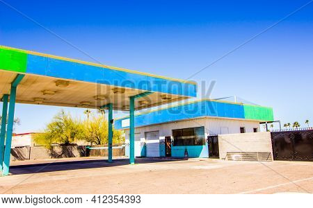 Abandoned Garage Building With Roll Up Doors & Large Overhang