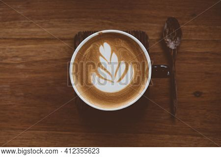 Cup Of Coffee Latte With Beautiful Latte Art On Wood Table Background,topview.