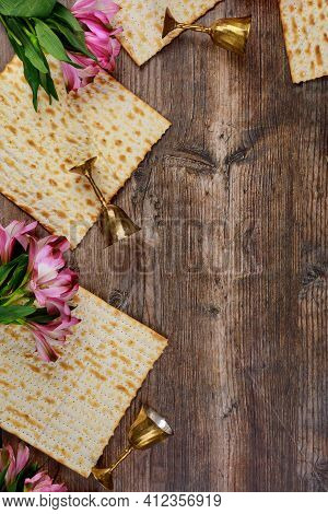 Jewish Matzah Bread On Wooden Rustic Background. Passover Holiday Concept