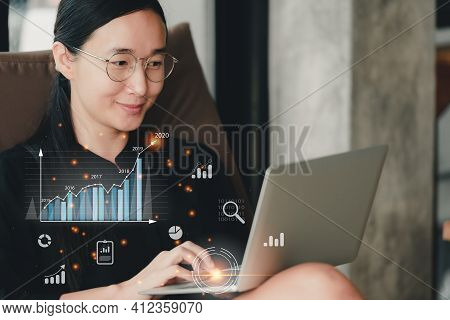 Beautiful Asian Girl Using A Notebook At Her House And Smiling Happily..plans To Increase Business G