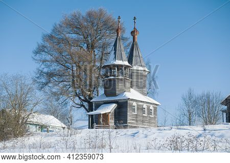 Old Wooden Chapel Of St. George The Victorious On A Frosty February Day. Arkhangelsk Region, Russia