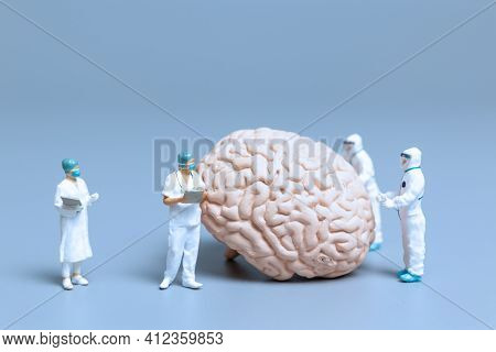 Miniature Doctor Checking And Analysis Alzheimer's Disease And Dementia Of Brain