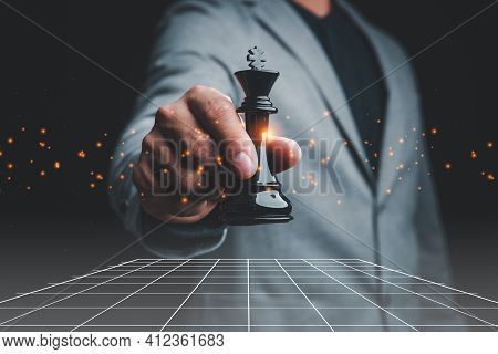 Businessman Holding King Chess Piece . Concept Of Business Strategy And Tactic.strategy, Management