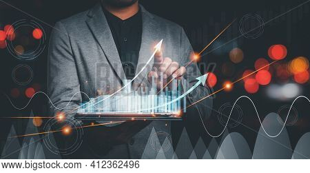 Businessman Use Tablet Plans To Increase Business Growth And An Increase In The Indicators Of Positi