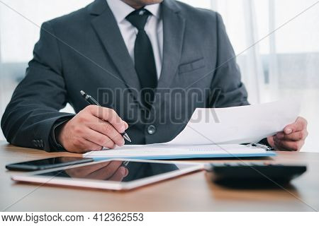Businessman Or Accountant Professional Manager Working With Finance Document. Accountant Signing Fin