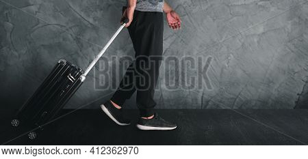 Man Travel Concept.man Dragging Suitcase Luggage Bag.walk On The Walkway With Cement Walls Copy Sapc