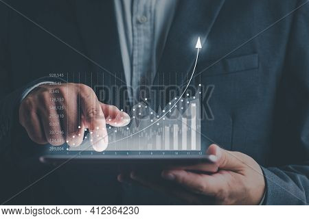 Business People Using Tablets And Using His Finger To Touch The Screen With A Business Graph Showing