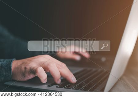 Data Search Technology Search Engine Optimization. Man's Hands Are Using A Computer Notebook To Sear