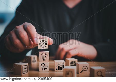 Hand Stack Woods Block Step On Table. Business Development Decide And Choose Concept. Targeting The