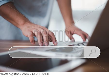 Data Search Technology Search Engine Optimization. Male Hands Are Using A Computer Notebook To Searc