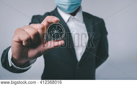 Businessman Holding A Navigation Compass In Hand With Copy Space Background. Business Planning And B