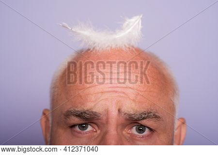 Senior Old Aged Head Of Bald Man. Hair Loss, Baldness With Feather